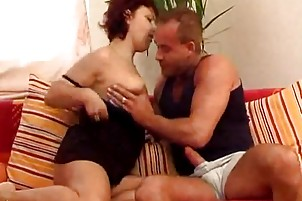 redheaded mommy copulates a boy on the family bed