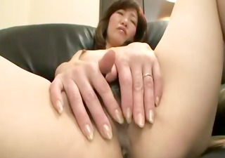 hairy asian cougar acquires fingered